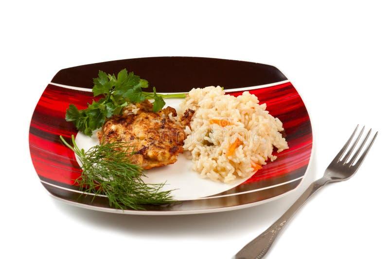 Plaque avec du riz et le bifteck frit image libre de droits