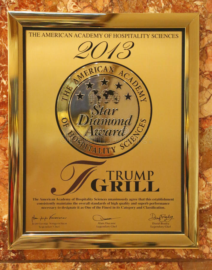 A plaque awarding the Trump Grill five stars by the American Academy of Hospitality Sciences displayed in the Trump Tower stock image