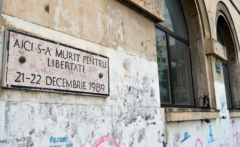 Plaque commemorates dead of 1989 Revolution in Piata 21 Decembrie. A small plaque commemorates those who died for freedom in Romanias Revolution of 1989 in Piata stock photos