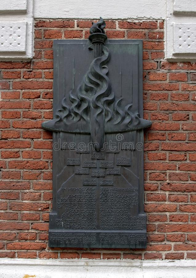 Plaque commemorating journalists who died in the crash of the Airliner Frankener, inner courtyard, Oost-Indisch Huis Building. Pictured is a bronze plaque in the stock photo
