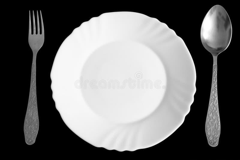 Plaque, cuillère et fourchette image libre de droits