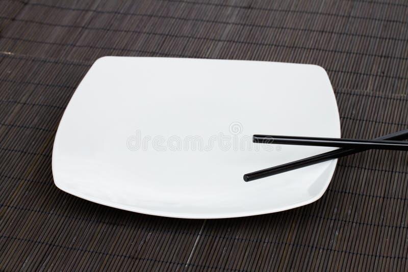 Plaque d'Emty - concept asiatique de nourriture photographie stock libre de droits