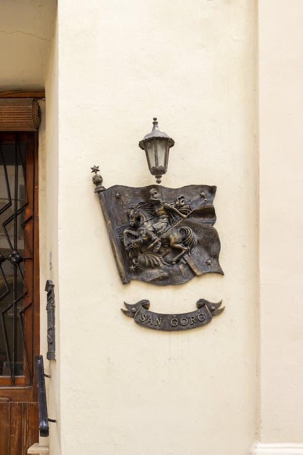 Plaque de mur de bâtiment de St George à Rabat, Gozo, Malte photo libre de droits