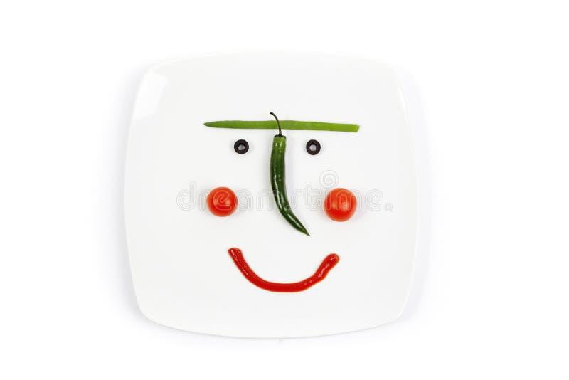 Plaque de sourire avec une tasse végétale image libre de droits