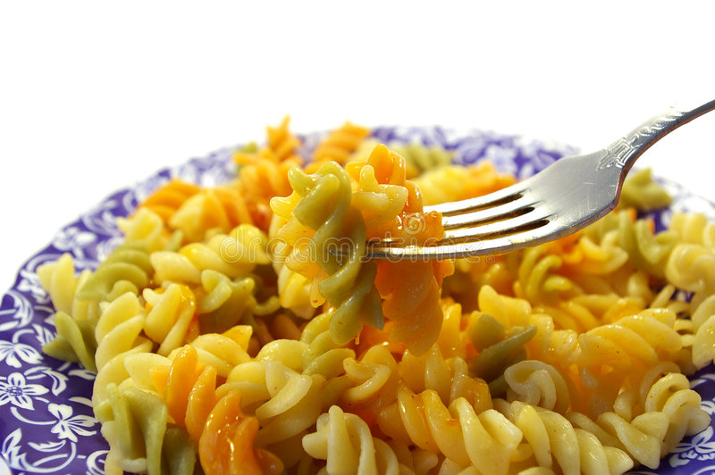 Plaque des macaronis tricolores photo stock