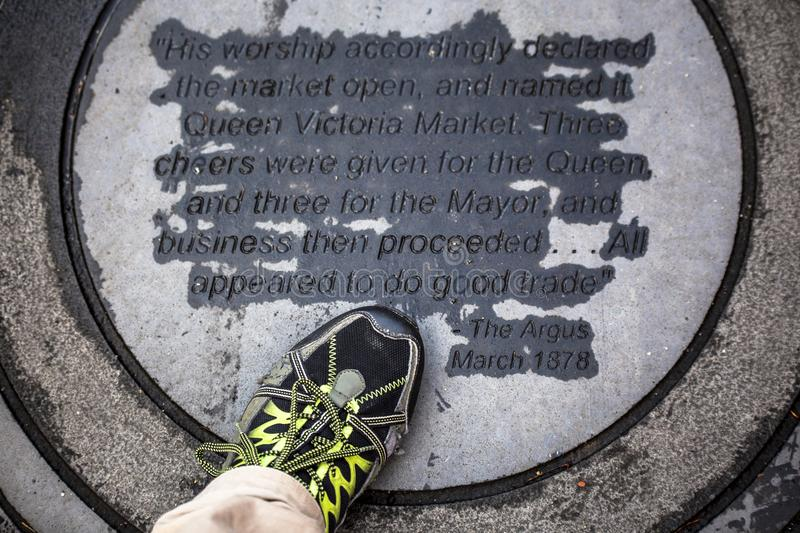 A 1878 plaque on ground declaring the opening of Queen Victoria Market Melbourne Australia. Australasia royalty free stock image