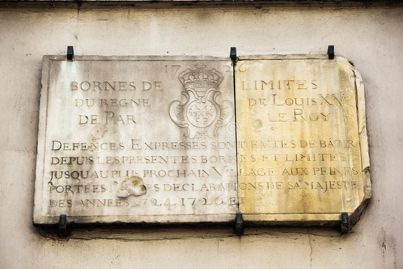 Plaque indicating the city limits of Paris. In 1726. Photo taken in the southeast of Paris royalty free stock photo