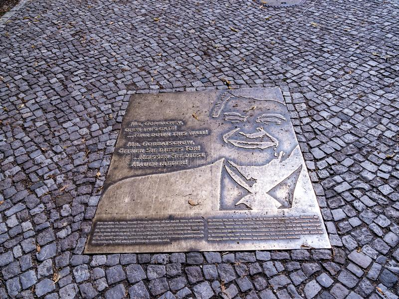 Plaque near the Brandenburg Gate is Berlin`s most famous landmark. A symbol of Berlin and German division during the Cold War stock images