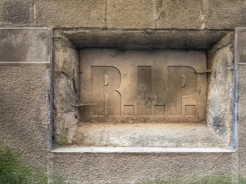 Plaque in old wall. RIP, rest in peace. Could be used for many things...year ending etc. Metaphor stock image