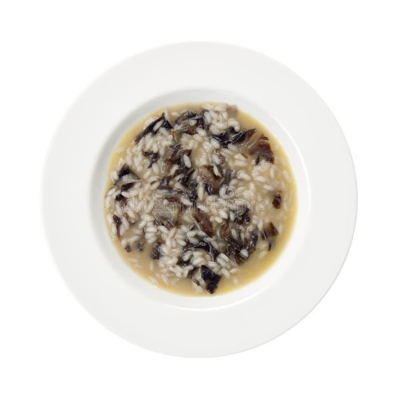 Plaque rouge de riz d'épinards d'endive d'isolement sur le blanc. images stock