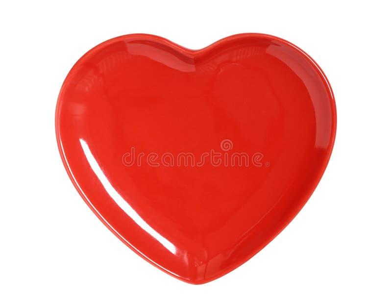 Plaque rouge lumineuse de coeur image libre de droits