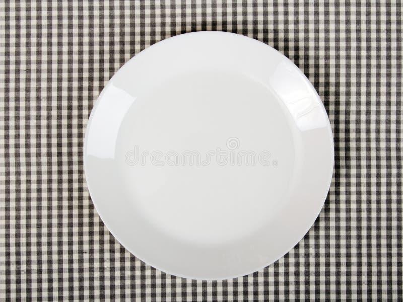 Plaque sur le tissu de table checkered images stock