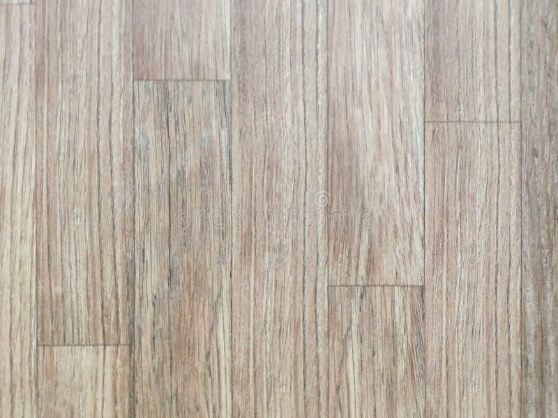 Plaques brun clair et beige de parquet stratifié, table ou portes en bois utilisées pour la décoration des matériaux naturels à l image libre de droits