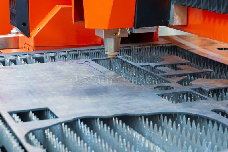 Plasma cutting machine cuts steel sheet. royalty free stock image