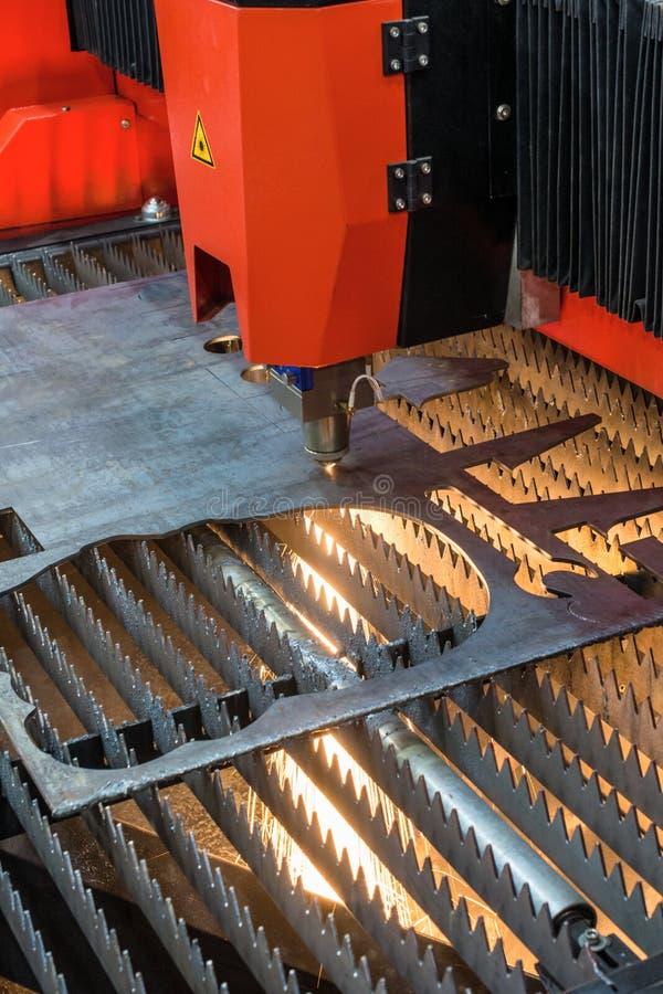 Plasma cutting machine cuts steel sheet. royalty free stock photos