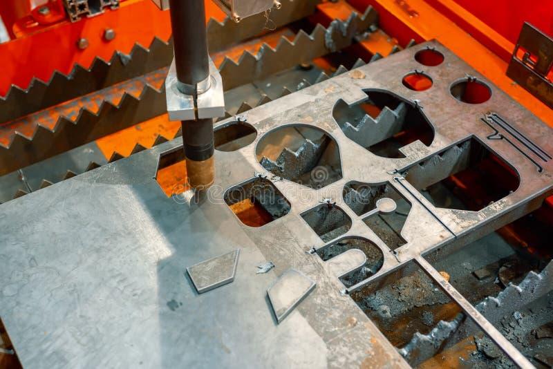 Plasma cutting machine cuts steel sheet. royalty free stock photography