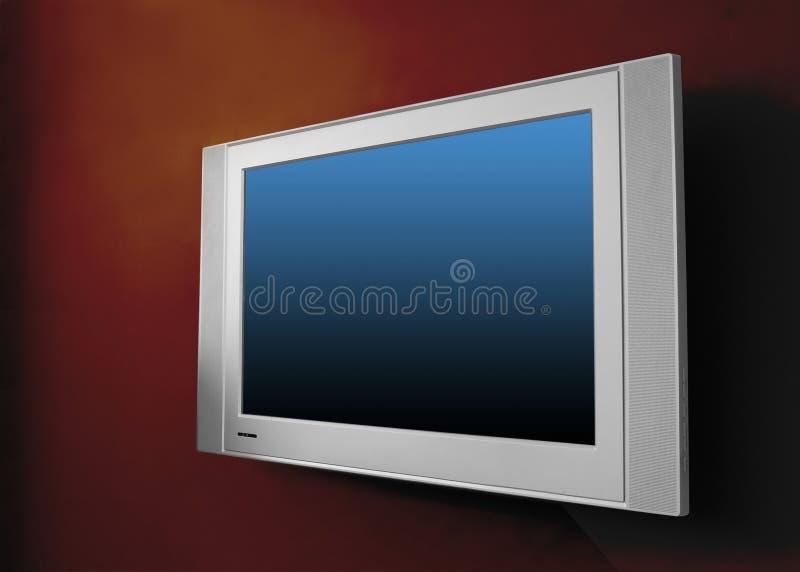 Plasma moderna TV en la pared marrón fotos de archivo
