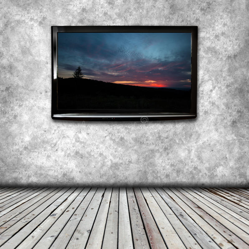 Plasma TV on the wall of the room. With wooden floor royalty free stock images