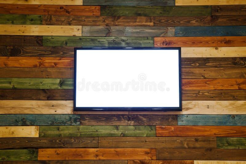 Plasmatv op de houten muur van de ruimte, het hangen van Plasmatv op muur stock afbeelding