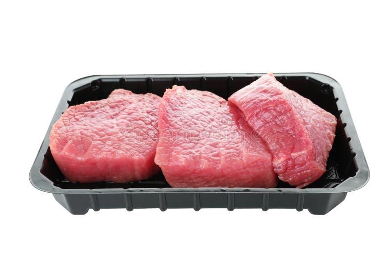 Plast- behållare med rått kött royaltyfria foton