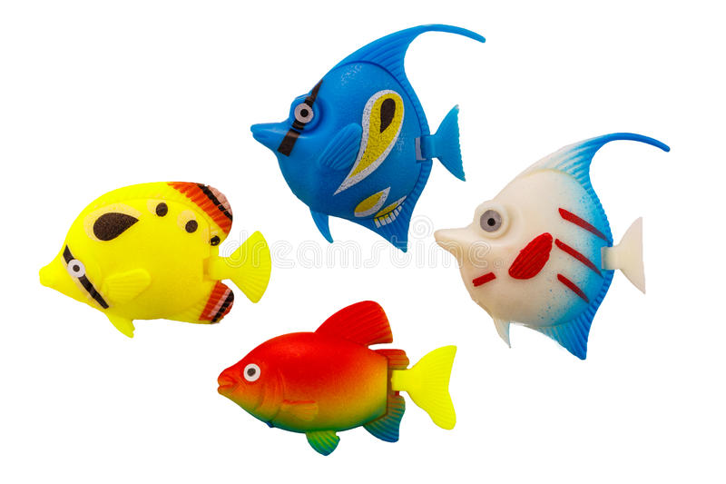 Plast- färgrikt för fiskleksak på isolerat arkivfoto