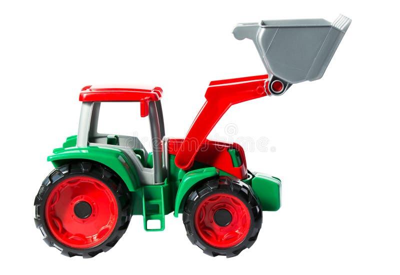 Plast- leksakgräsplan med den röda traktoren som isoleras på vit bakgrund fotografering för bildbyråer
