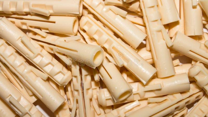 Plast- proppar för skruvar arkivbilder