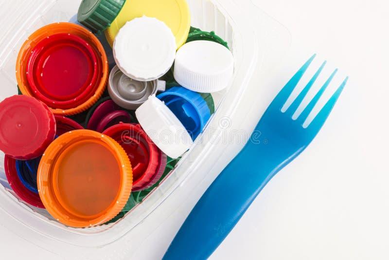 Plast-proppar och gaffel royaltyfri foto