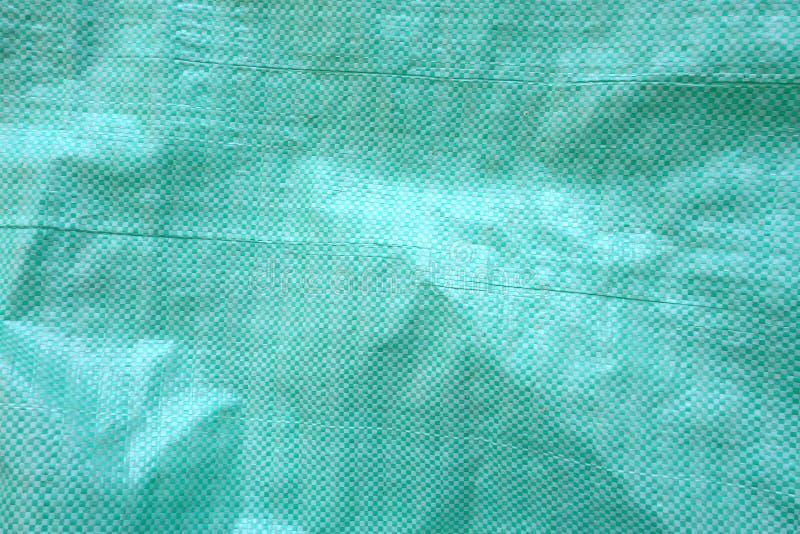 Plast- säcktexturbakgrund arkivfoto