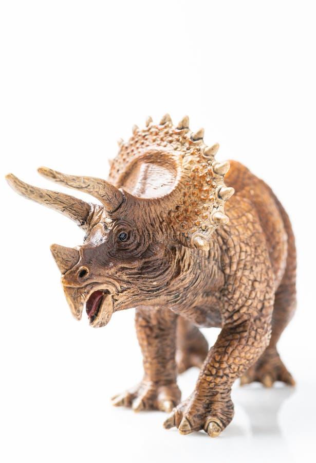 Plast- statyett för Triceratops i vit bakgrund arkivbilder