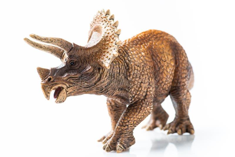 Plast- statyett för Triceratops i vit bakgrund arkivfoto