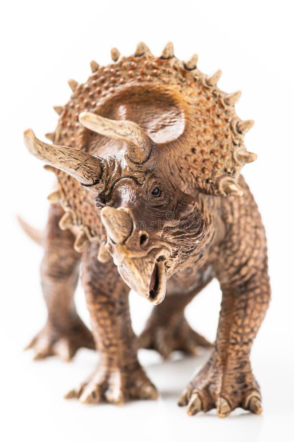 Plast- statyett för Triceratops i vit bakgrund arkivbild