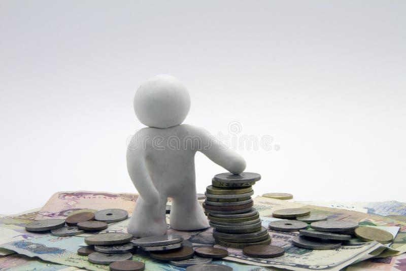 Plastelina pieniądze i charakter zdjęcia stock