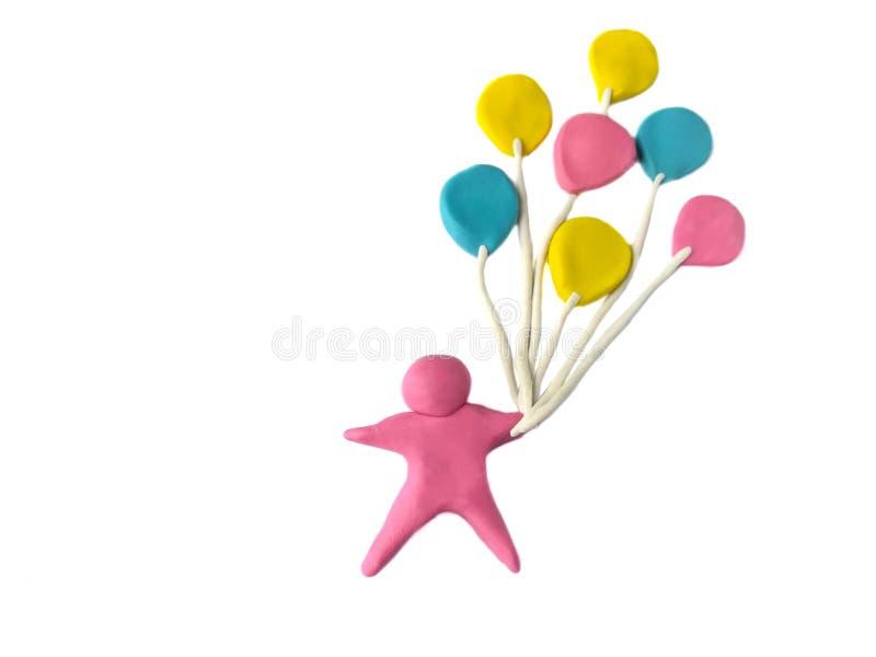 Plasteliny szczęścia gliniany dziecko, trzyma kolorowego balon obrazy royalty free