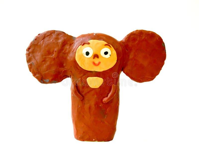 Plastellinadiagram Cheburashkaen på en vit bakgrund Kreativitet för barn` s arkivfoton
