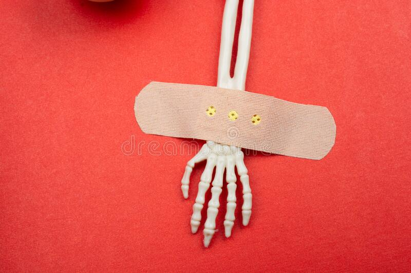 Plaster band on Bones of the  Skeletal human hand. Plaster band on Skeletal hands for death and mistery concept royalty free stock photos