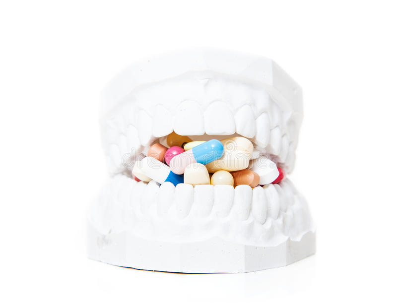 Plaster cast of teeth full of pharmaceuticals royalty free stock photo