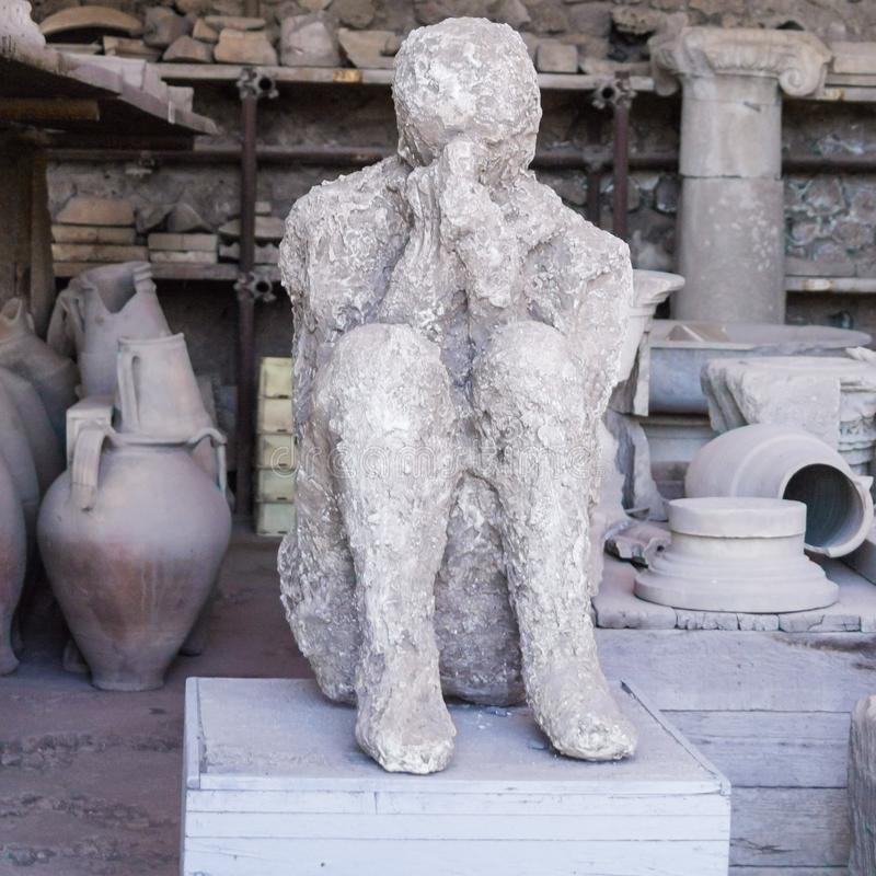 Plaster cast of victim of Vesuvius eruption in Pompeii royalty free stock photo