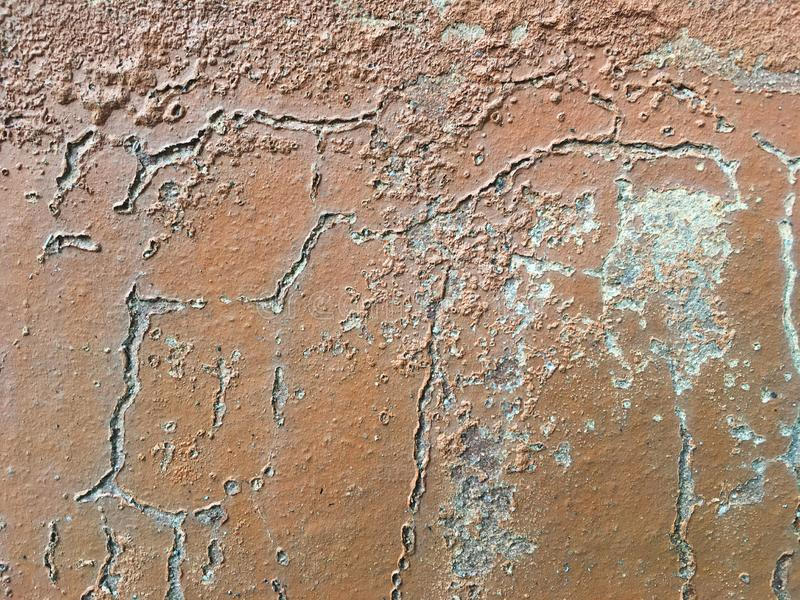 Erode brown wall. Plaster color cracked Erode brown wall stock photos
