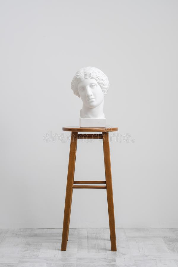 Free Plaster Head, Antique Sculpture For Learning To Draw. Standing On A Stool On A White Background. Stock Image - 138112941