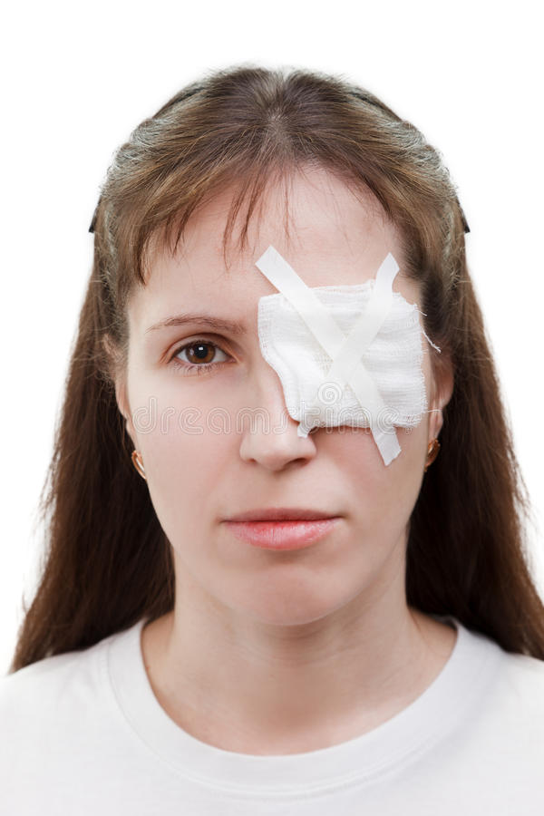 Plaster patch on wound eye stock photography