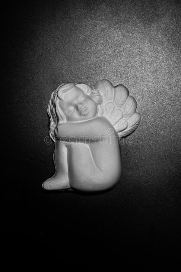 Plaster sculpture of little cherub. stock photos