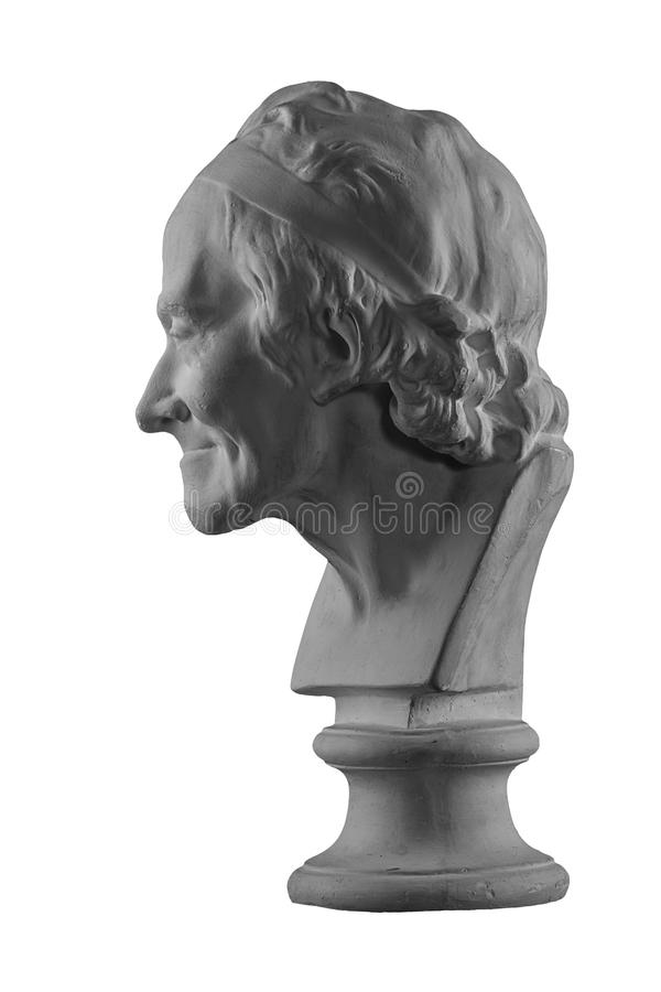 Plaster statue of the bust of an old man. White plaster bust, figure sculptural portrait statue of the bust of an old man royalty free stock photography