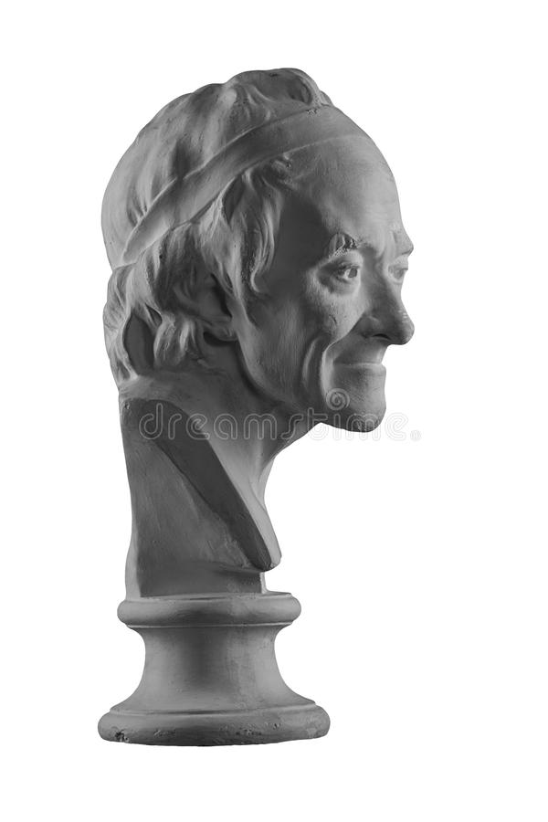 Plaster statue of the bust of an old man. White plaster bust, figure sculptural portrait statue of the bust of an old man royalty free stock images
