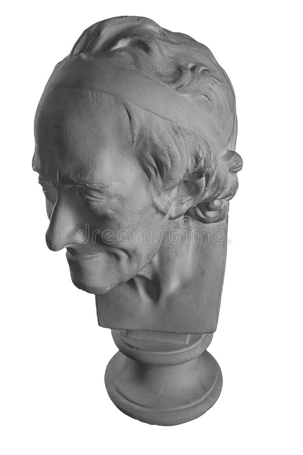 Plaster statue of the bust of an old man. White plaster bust, figure sculptural portrait statue of the bust of an old man royalty free stock photos