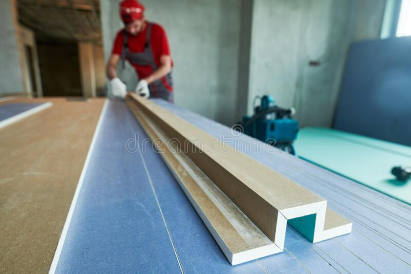 Plasterboard work. worker assembling gypsum drywall construction royalty free stock photography