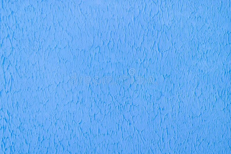 Plastered concrete wall, painted in bright blue, decorative surface texture stock image