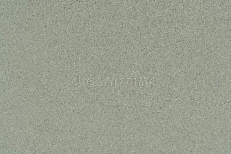 Plastered concrete wall, painted in gray-green, surface texture royalty free stock photography
