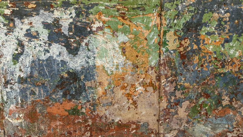 Plastered wall, with old multi-colored paint with green, red, gray shades stock photography