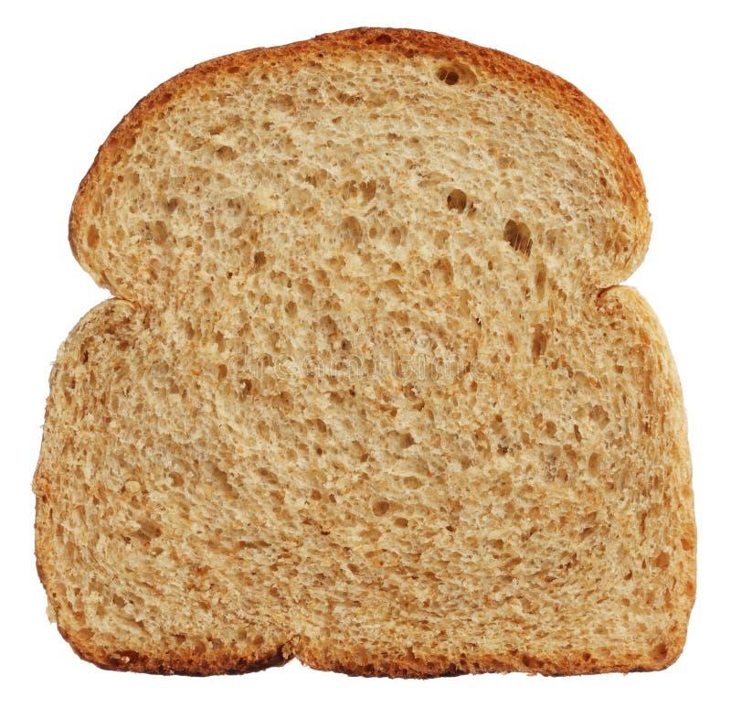 Plasterek odizolowywający na bielu wholewheat chleb zdjęcia stock